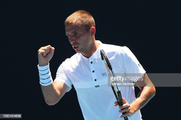 Daniel Evans of Great Britain celebrates a point in his match against Paolo Lorenzi of Italy during Qualifying ahead of the 2019 Australian Open at...
