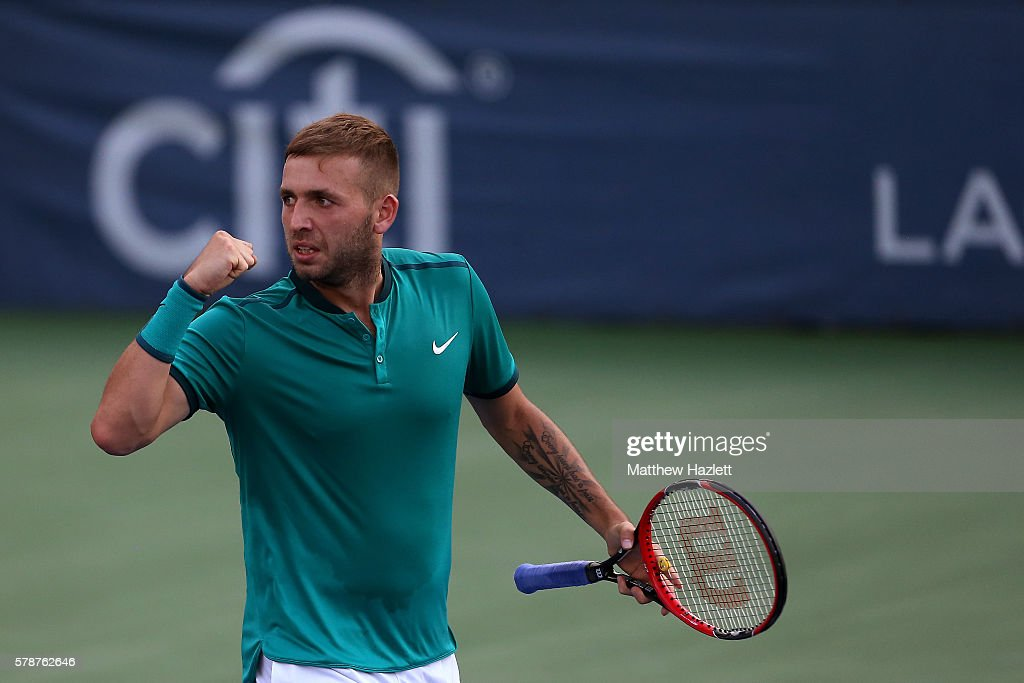 Daniel Evans of Great Britain celebrates after defeating Grigor Dimitrov of Bulgaria 6-4, 6-4 during day 2 of the Citi Open at Rock Creek Tennis Center on July 19, 2016 in Washington, DC.