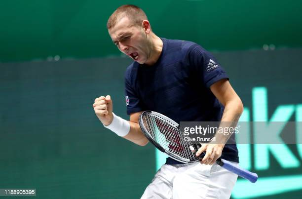 Daniel Evans of Great Britain celebrates during his Davis Cup Group Stage match against Robin Haase of the Netherlands during Day Three of the 2019...