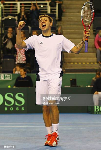 Daniel Evans of Great Britain celebrates his win against Martin Klizan of the Slovak Republic during the final day of the Davis Cup match between...