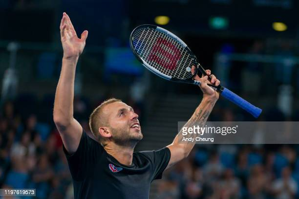 Daniel Evans of Great Britain celebrates winning the match point during his Group C singles match against David Goffin of Belgium during day three of...