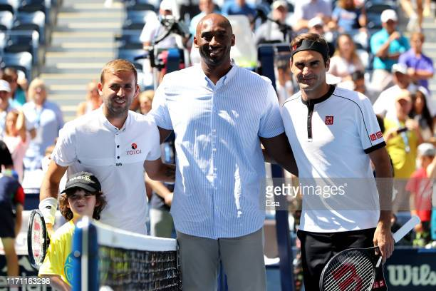 Daniel Evans of Great Britain, former NBA player Kobe Bryant and Roger Federer of Switzerland pose for a photo prior to their Men's Singles third...