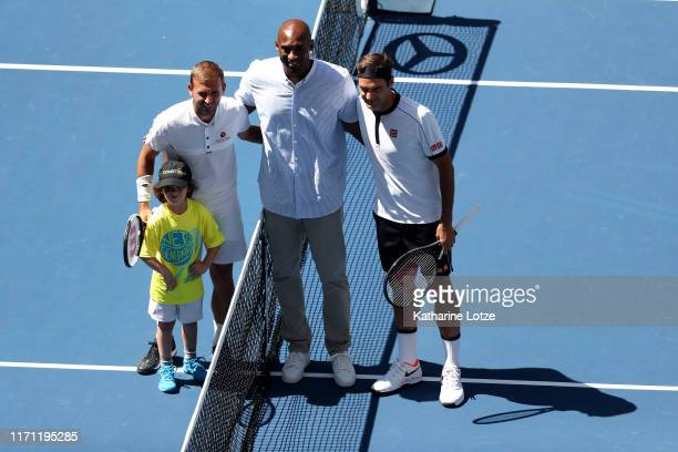 Daniel Evans of Great Britain, former NBA player Kobe Bryant, and Roger Federer of Switzerland pose for a photo ahead of Evans and Federer's Men's...
