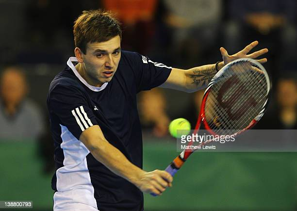 Daniel Evans of Great Britain in action against Martin Klizan of the Slovak Republic during the final day of the Davis Cup match between Great...