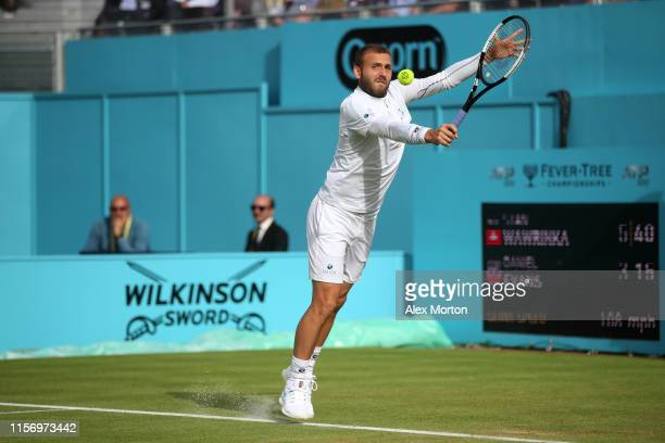 Daniel Evans of Great Britain plays a backhand during his First Round Singles Match against Stan Wawrinka of Switzerland during day Three of the...