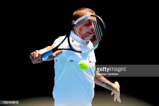 Daniel Evans of Great Britain plays a backhand in his match against Paolo Lorenzi of Italy during Qualifying ahead of the 2019 Australian Open at...