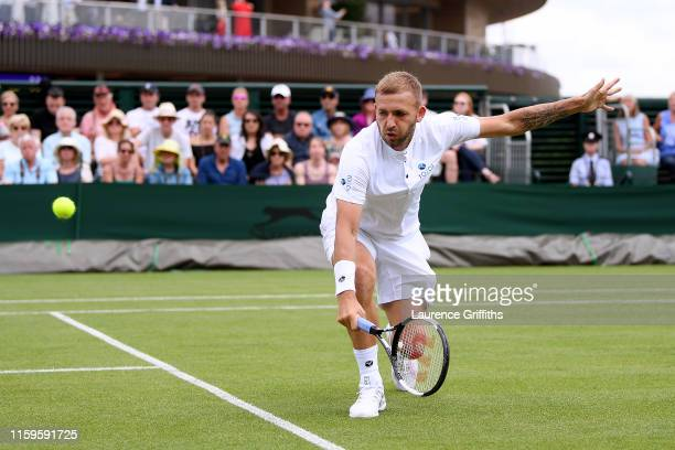 Daniel Evans of Great Britain plays a backhand in his Men's Singles first round match against Federico Delbonis of Argentina during Day two of The...