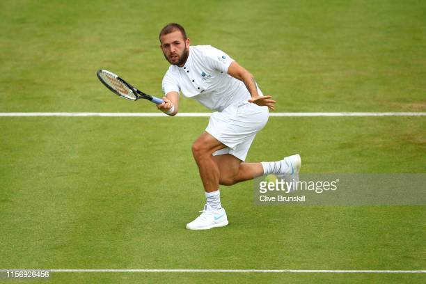 Daniel Evans of Great Britain plays a forehand during his First Round Singles Match against Stan Wawrinka of Switzerland during day Three of the...