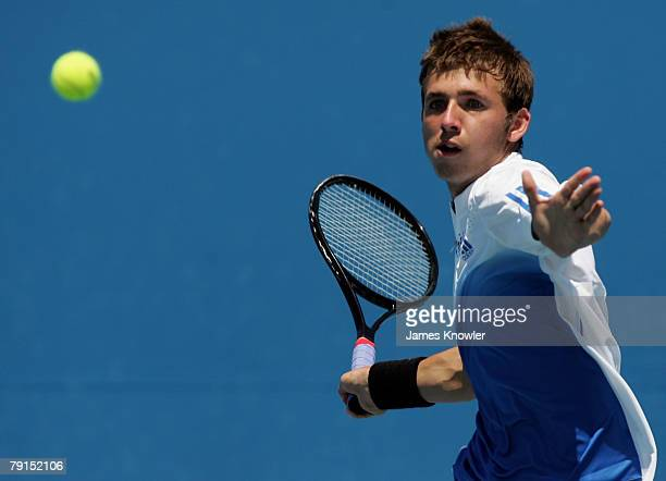 Daniel Evans of Great Britain plays a forehand during his junior boys match against Xander Spong of the Netherlands on day nine of the Australian...