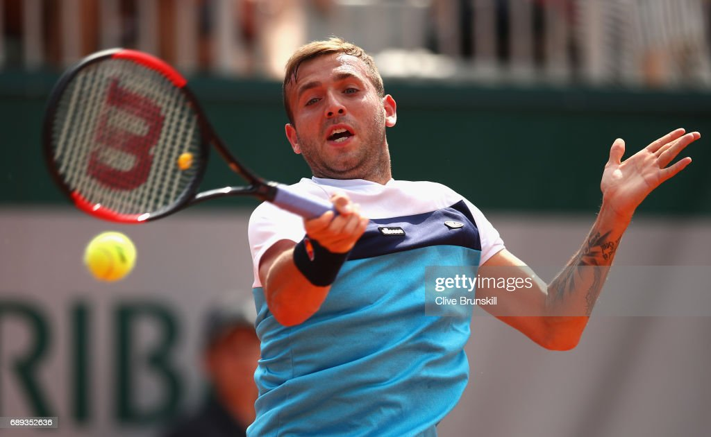 Daniel Evans of Great Britain plays a forehand during the mens singles first round match against Tommy Robredo of Spain on day one of the 2017 French Open at Roland Garros on May 28, 2017 in Paris, France.
