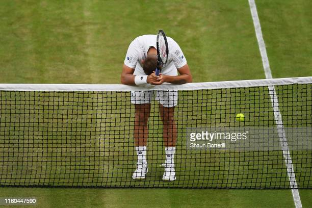 Daniel Evans of Great Britain reacts at the net after defeat in his Men's Singles third round match against Joao Sousa of Portugal during Day six of...