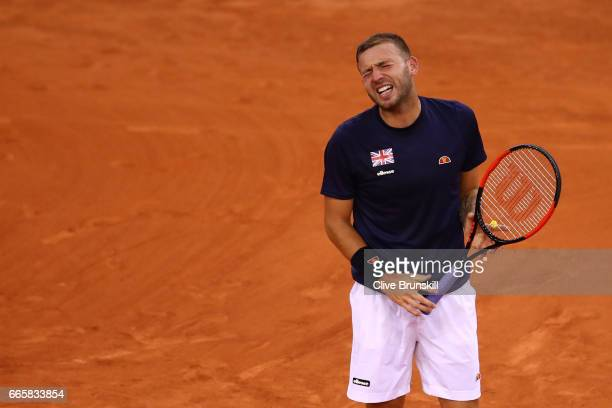Daniel Evans of Great Britain reacts during the singles match against Jeremy Chardy of France on day one of the Davis Cup World Group QuarterFinal...