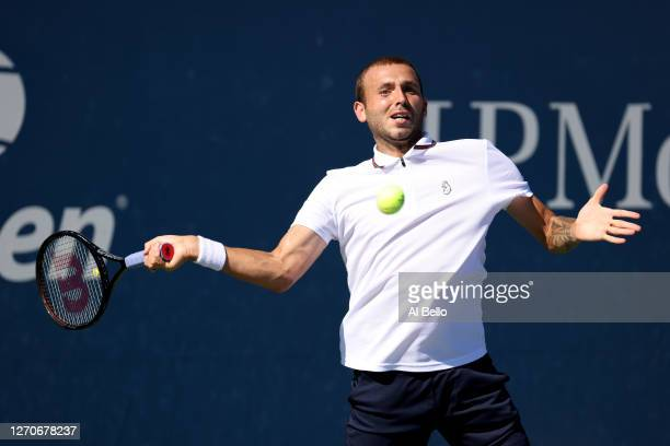 Daniel Evans of Great Britain returns the ball during his Men's Singles second round match against Corentin Moutet of France on Day Five of the 2020...