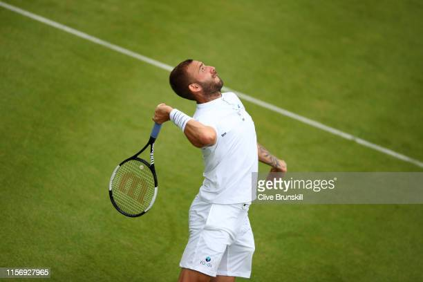 Daniel Evans of Great Britain serves during his First Round Singles Match against Stan Wawrinka of Switzerland during day Three of the Fever-Tree...