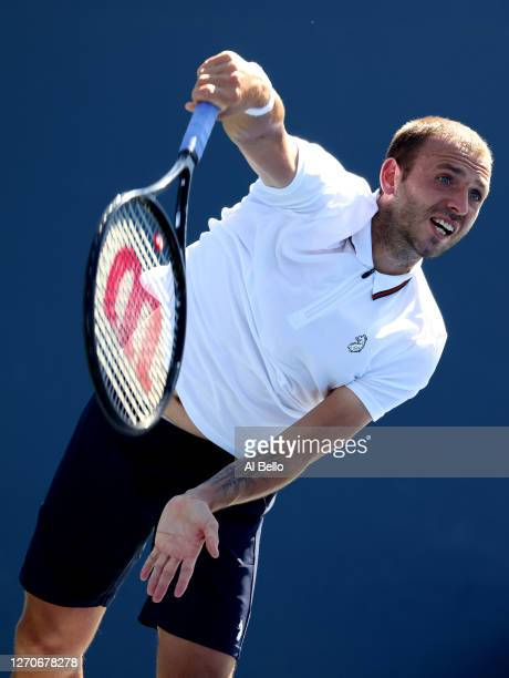 Daniel Evans of Great Britain serves the ball during his Men's Singles second round match against Corentin Moutet of France on Day Five of the 2020...