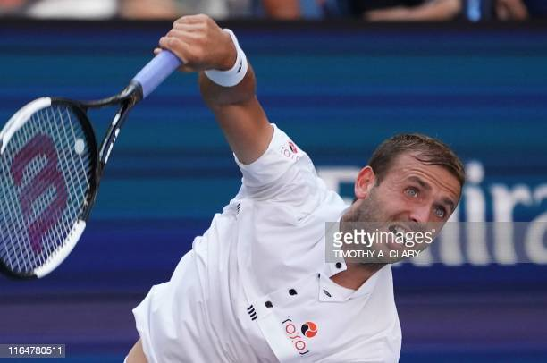 Daniel Evans of Great Britain serves to Roger Federer of Switzerland during their Round Three Men's Singles match at the 2019 US Open at the USTA...
