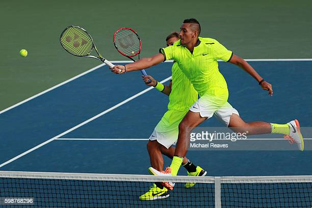 Daniel Evans of Great Britan and Nick Kyrgios of Australia in action against Taylor Fritz and Tommy Paul of the United States during their second...