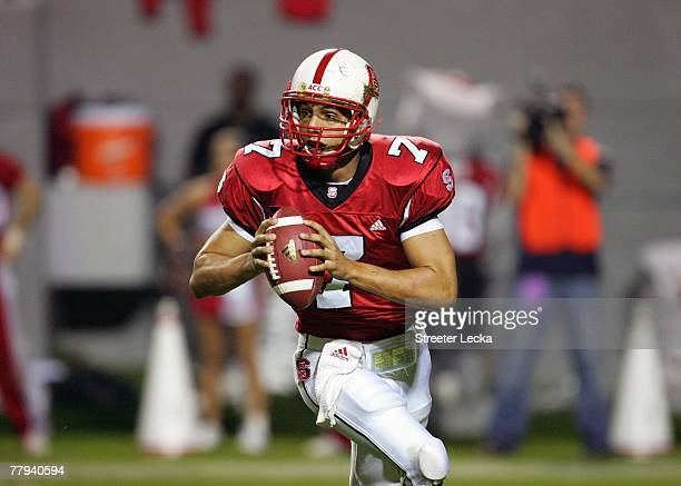 Daniel Evans of the North Carolina State Wolfpack looks to pass the ball during the game against the Virginia Cavaliers at Carter-Finley Stadium...