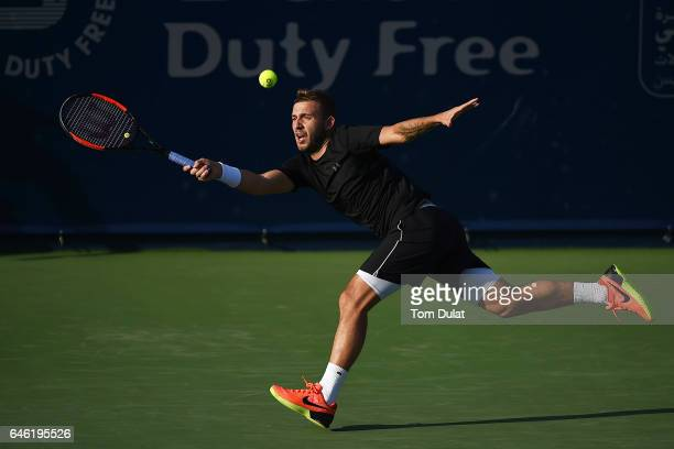 Daniel Evans of United Kingdom returns a shot during his match against Dustin Brown of Germany on day three of the ATP Dubai Duty Free Tennis...