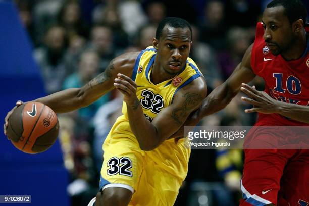 Daniel Ewing of Asseco Prokom competes with JR Holden, #10 of CSKA Moscow during the Euroleague Basketball 2009-2010 Last 16 Game 4 between Asseco...