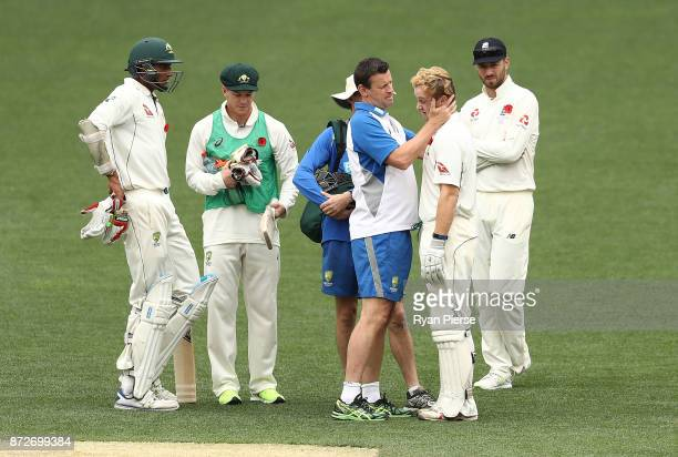 Daniel Fallins of CA XI passes a concussion test after being hit on the helmet by a delivery from Craig Overton of England during day four of the...