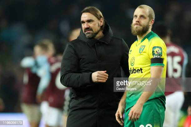Daniel Farke, manager of Norwich City and Teemu Pukki show their dejection after the Premier League match between Aston Villa and Norwich City at...