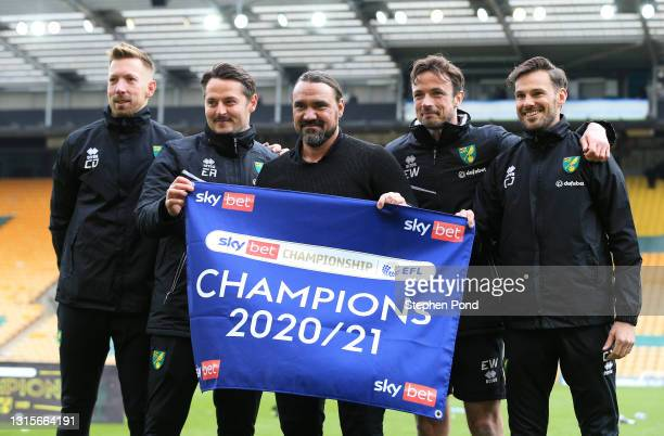 Daniel Farke, Manager of Norwich City celebrates with his backroom staff after winning the Sky Bet Championship after the Sky Bet Championship match...