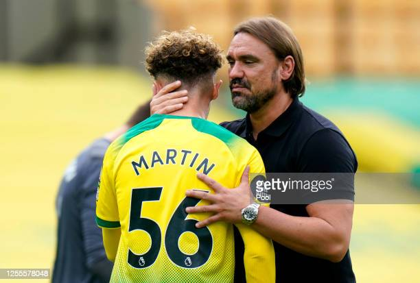 Daniel Farke, Manager of Norwich City consoles Josh Martin of Norwich City on the final whistle, upon their team's relegation, following the Premier...