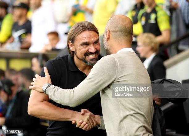 Daniel Farke, Manager of Norwich City greets Pep Guardiola, Manager of Manchester City prior to the Premier League match between Norwich City and...