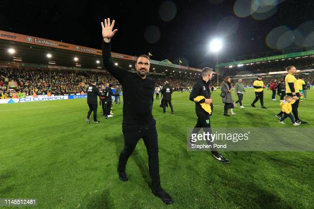 Daniel Farke, Manager of Norwich City shows appreciation to the fans as his team secure promotion to the Premier League following their victory in...