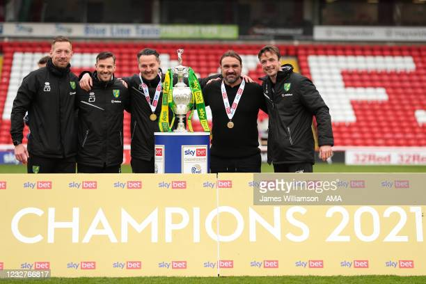 Daniel Farke the manager \ head coach of Norwich City and coaching staff pose with the Sky Bet Championship trophy during the Sky Bet Championship...