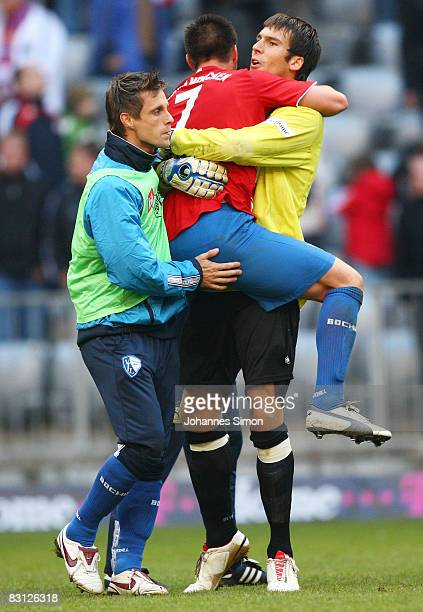 Daniel Fernandes goalkeeper of Bochum celebrates with teammates after the Bundesliga match between Bayern Muenchen and VfL Bochum at the Allianz...