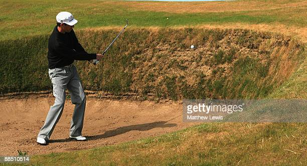 Daniel Field of East Herts plays out of the bunker on the 11th hole during the Glenmuir PGA Professional Championship at Dondoanld Links on June 16...