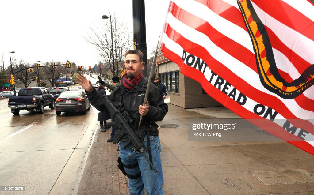Daniel Fithian holds his Scar 16S .556 rifle at a pro gun rally on April 21, 2018 in Boulder, Colorado. The city of Boulder is considering enacting an ordinance that will ban the sale and possession of assault weapons in the city.