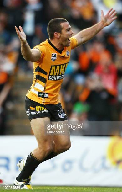 Daniel Fitzhenry of the Tigers celebrates his try during the round 15 NRL match between the Wests Tigers and the Canberra Raiders at Leichhardt Oval...