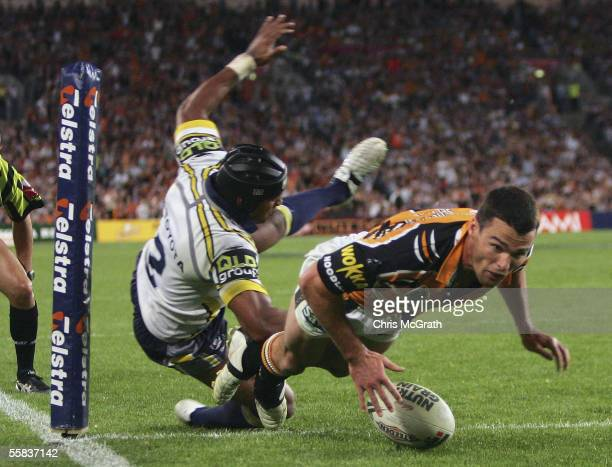 Daniel Fitzhenry of the Tigers dives over for a try during the NRL Grand Final between the Wests Tigers and the North Queensland Cowboys at Telstra...