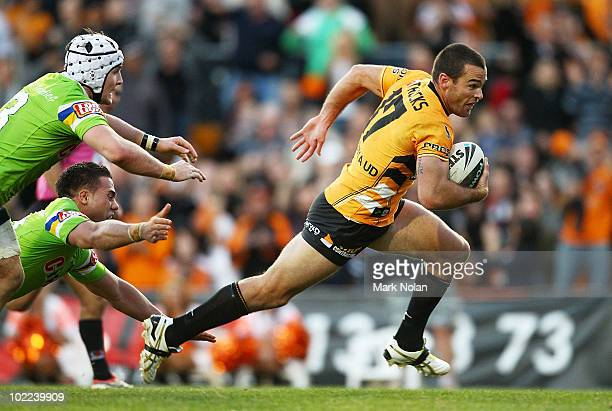 Daniel Fitzhenry of the Tigers heads for the try line to score during the round 15 NRL match between the Wests Tigers and the Canberra Raiders at...