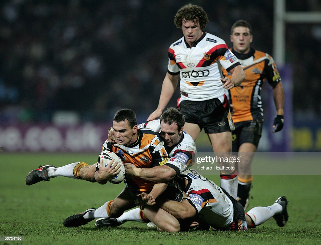 Daniel Fitzhenry of Tigers is tackled by Paul Johnson of Bradford during the Carnegie World Club Challenge between Bradford Bulls and Wests Tigers at the Galpharm Stadium on February 03, 2006 in Huddersfield, England
