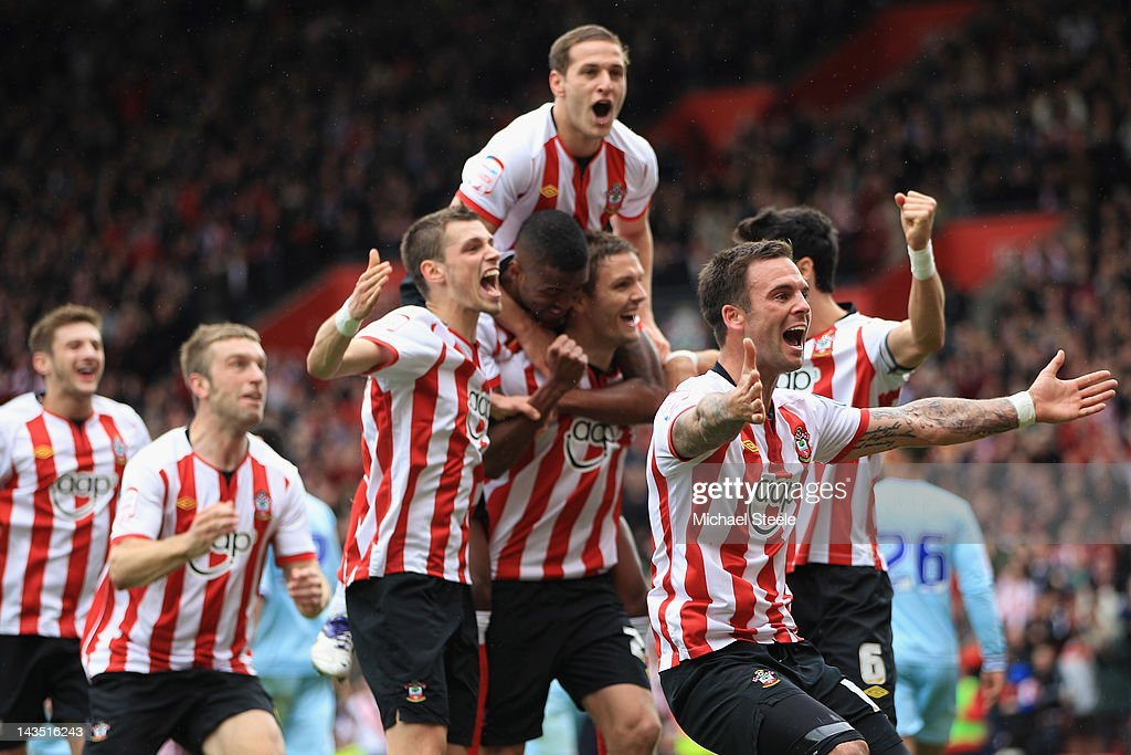 Daniel Fox (R) leads the Southampton celebrations after his sides third goal scored by Jos Hooiveld during the npower Championship match between Southampton and Coventry City at St Mary's Stadium on April 28, 2012 in Southampton, England.