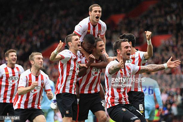 Daniel Fox leads the Southampton celebrations after his sides third goal scored by Jos Hooiveld during the npower Championship match between...