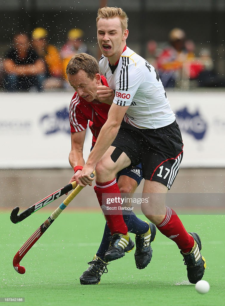 Daniel Fox of England and Jan Christopher Ruehr of Germany contest for the ball during the match between England and Germany during day two of the Champions Trophy on December 2, 2012 in Melbourne, Australia.