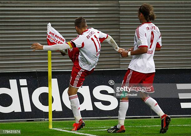 Daniel Frahn of Leipzig celebrates after scoring his team's second goal by kicking the corner flag during the Third League match between RB Leipzig...