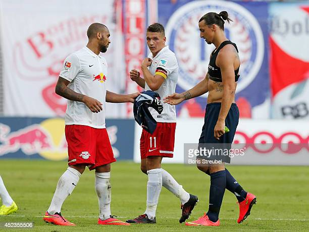 Daniel Frahn of Leipzig watches team mate Terrence Boyd exchanging his jersey with Zlatan Ibrahimovic of Paris during the pre season friendly match...