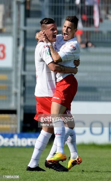 Daniel Franziskus of Regensburg celebrates with teammates after scoring his team's second goal during the Third League match between Jahn Regensburg...