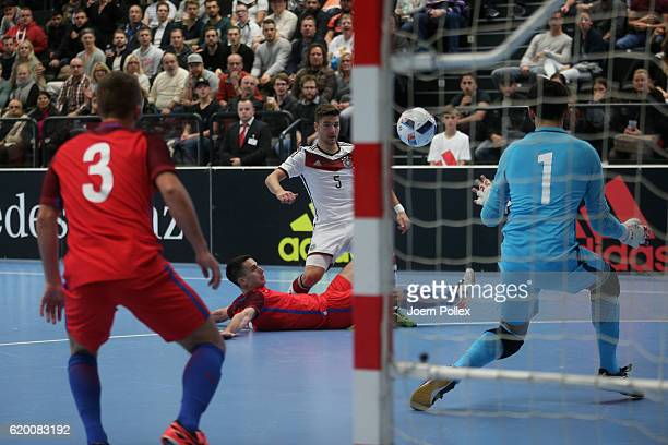 Daniel Fredel of Germany scores his team's first goal during the Futsal International Friendly match between Germany and England at Inselparkhalle on...
