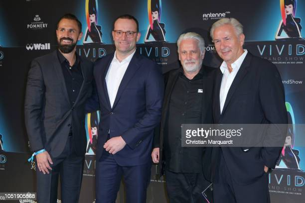 Daniel Funke Jens Spahn Joern Kubicki and Klaus Wowereit attend the VIVID Grand Show premiere at FriedrichstadtPalast on October 11 2018 in Berlin...
