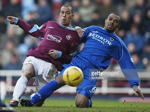 Daniel Gabbidon of Cardiff City tries to tackle Bobby Zamora of West Ham United during the Nationwide Division One match between West Ham United and...