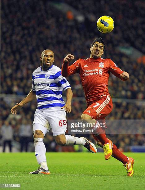 Daniel Gabbidon of QPR in action with Luis Suarez of Liverpool during the Barclays Premier league match between Liverpool and Queens Park Rangers at...