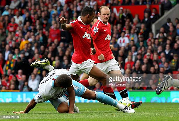 Daniel Gabbidon of West Ham United is unable to stop Nani of Manchester United scoring his team's second goal during the Barclays Premier League...