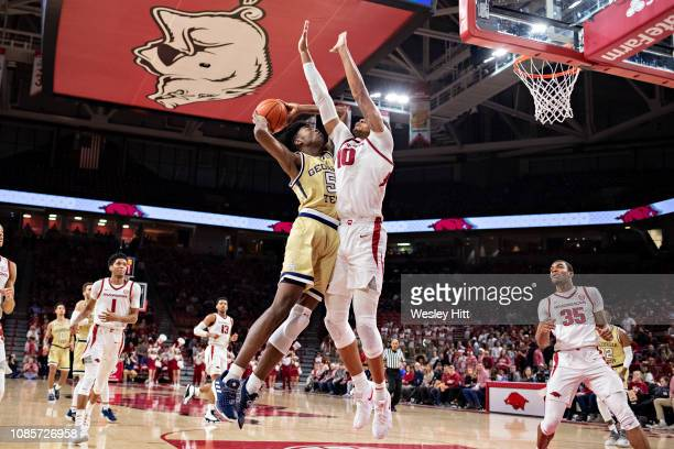 Daniel Gafford of the Arkansas Razorbacks defends Moses Wright of the Georgia Tech Yellow Jackets at Bud Walton Arena on December 19 2018 in...